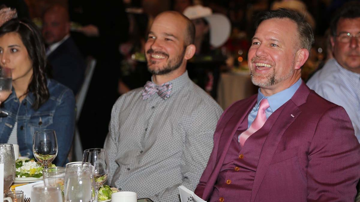 Image of Tim Gebhart and Sean Casey sitting at a Gala table.
