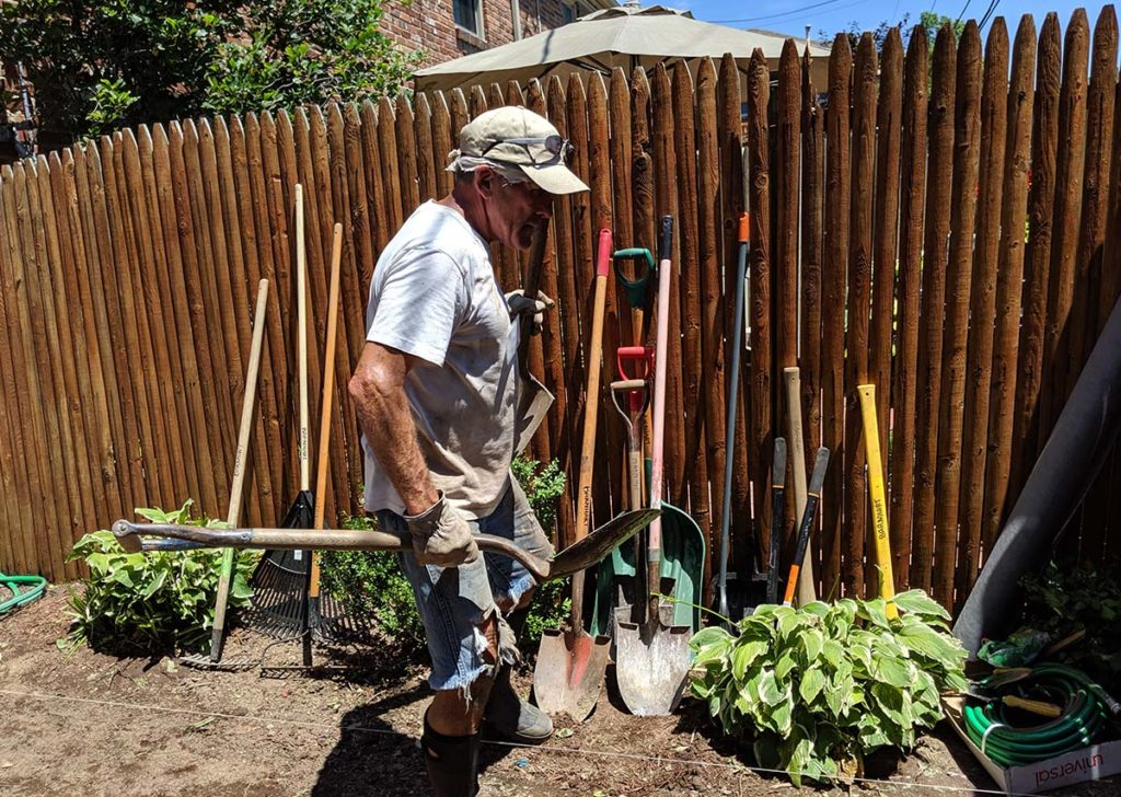 Image of volunteer working in a garden.