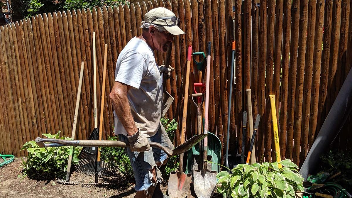 Image of volunteer working in a garden.