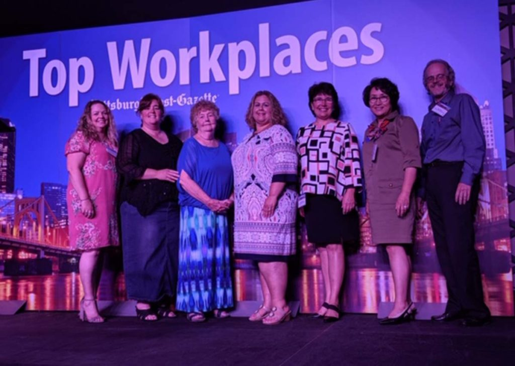 Image of Emmaus employees at the Top Workplace award ceremony.