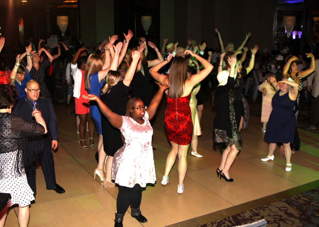 Image of people dancing at Emmaus Gala