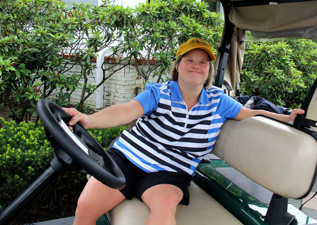 Image of disabled girl on golf cart