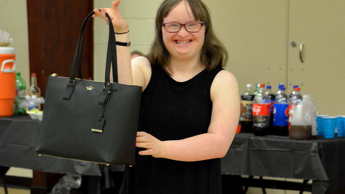 Image of Young Disabled Girl at Emmaus Purse Bash